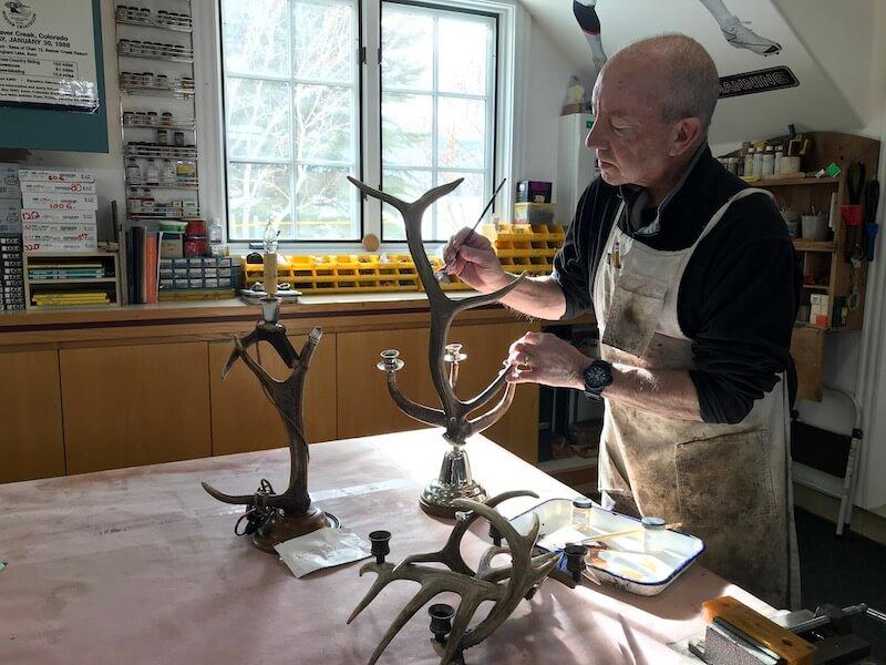Victor working on an antler light fixture